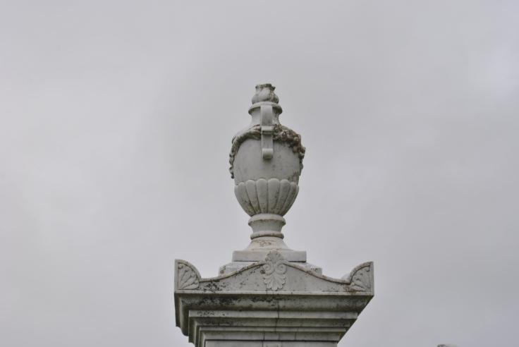 white urn grave grey sky