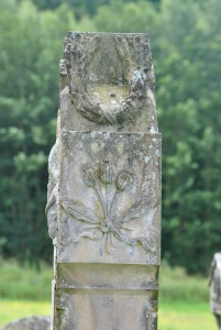 three thistles on side of gravestone