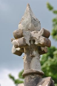 elaborately carved stone head on mausoleum